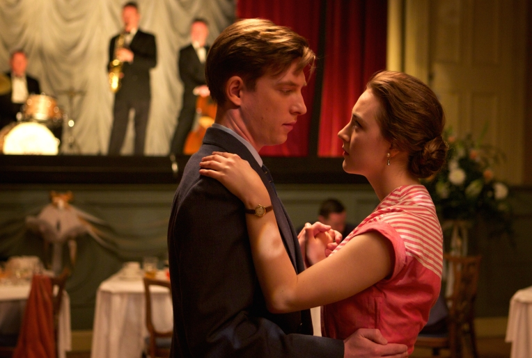 """Domhnall Gleeson as """"Jim"""" and Saoirse Ronan as """"Eilis"""" in BROOKLYN. Photo by Kerry Brown. © 2015 Twentieth Century Fox Film Corporation All Rights Reserved"""